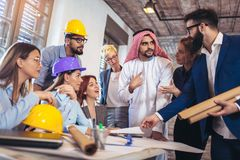 Arabic and business people speaking about investments. Arabic and western business people speaking about investments Stock Photos