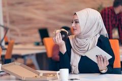 Arabic business woman wearing hijab,working in startup office. Young Arabic business woman wearing hijab,working in her startup office. Diversity, multiracial Royalty Free Stock Photos