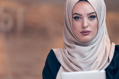 Arabic business woman wearing hijab,working in startup office. Young Arabic business woman wearing hijab,working in her startup office. Diversity, multiracial Royalty Free Stock Photo