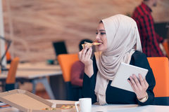 Arabic business woman wearing hijab,working in startup office. Young Arabic business woman wearing hijab,working in her startup office. Diversity, multiracial Royalty Free Stock Photography