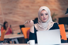Arabic business woman wearing hijab,working in startup office. Royalty Free Stock Images
