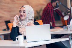 Arabic business woman wearing hijab,working in startup office. Young Arabic business women wearing hijab,working in her startup office. Diversity, multiracial Royalty Free Stock Image
