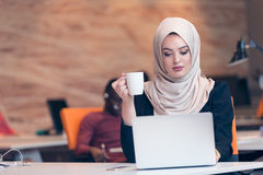 Arabic business woman wearing hijab,working in startup office. Young Arabic business women wearing hijab,working in her startup office. Diversity, multiracial Royalty Free Stock Photo