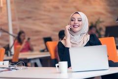 Arabic business woman wearing hijab,working in startup office. Young Arabic business women wearing hijab,working in her startup office. Diversity, multiracial Stock Image