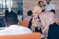 Arabic business woman wearing hijab,working in startup office. Young Arabic business women wearing hijab,working in her startup office. Diversity, multiracial Royalty Free Stock Photos