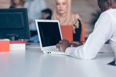 Arabic business woman wearing hijab,working in startup office. Young Arabic business women wearing hijab,working in her startup office. Diversity, multiracial Royalty Free Stock Photography
