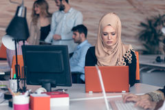 Arabic business woman wearing hijab,working in startup office. Young Arabic business women wearing hijab,working in her startup office. Diversity, multiracial Stock Photography