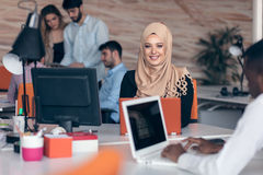 Arabic business woman wearing hijab,working in startup office. Young Arabic business women wearing hijab,working in her startup office. Diversity, multiracial Royalty Free Stock Images