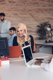 Arabic business woman wearing hijab,working in startup office. Stock Photos