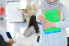 Arabic business woman working in team with her colleagues at startup office Stock Image
