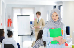 Arabic business woman working in team with her colleagues at startup office Royalty Free Stock Images