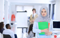 Arabic business woman working in team with her colleagues at startup office Stock Photography