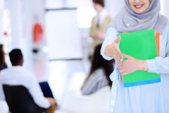 Arabic business woman working in team with her colleagues at startup office Royalty Free Stock Photo