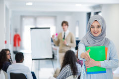 Arabic business woman working in team with her colleagues at startup office Stock Photos