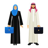 Arabic businessman and businesswoman with leather diplomats illustration. Arabic businessman and businesswoman in traditional ethnic clothing and with leather Royalty Free Stock Photos