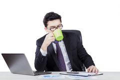 Arabic businessman enjoy coffee and working Stock Photos