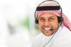 Arabic businessman headphone. Arabic businessman with headphone in office stock photo