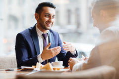 Arabic Businessman at Meeting in Cafe Royalty Free Stock Photography