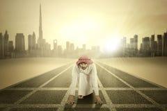 Arabic businessman ready to race Royalty Free Stock Photo