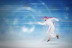 Arabic businessman running inside cyberspace Royalty Free Stock Photos
