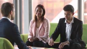 Arabic businessman talk to caucasian customer sign contract handshake client. Arabic businessman talk to caucasian customer make business agreement handshake stock footage