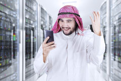 Arabic businessman using his phone stock photography