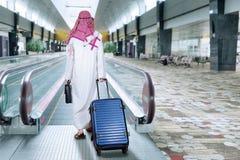 Arabic businessman walks in escalator Stock Photography