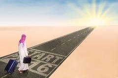 Arabic businessman walks on the highway royalty free stock photo