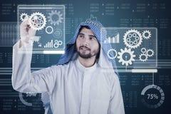 Arabic businessman works with virtual screen stock photo