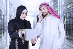 Arabic businesspeople working in server room Stock Images