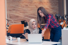 Arabic businesswoman wearing hijab receiving notification from a colleague Royalty Free Stock Photos