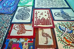 Arabic calligraphy in appliqued pieces, Tentmakers alley, Cairo,. The stall of Tentmakers alley Sharia Khayamiya with fine examples of patchwork, embroidery royalty free stock photos
