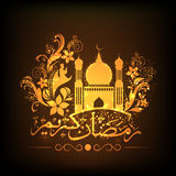 Arabic calligraphy with golden Mosque for Ramadan Kareem. Stock Image