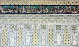 Arabic calligraphy and mosaics. A beautiful interior design of the mosque royalty free stock image