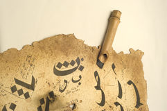 Arabic Calligraphy on paper stock photos