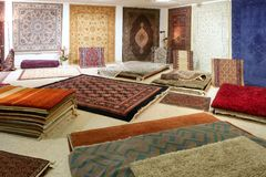 Arabic carpet shop exhibition colorful carpets. Exposition room Stock Images