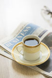 Arabic coffee and newspaper Stock Image