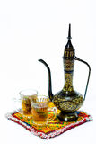 Arabic coffee pot. With a cup of coffee symbolising arabic hospitality and welcoming a guest Stock Photography