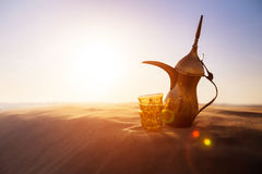 Arabic Coffee Pot. On desert dunes Royalty Free Stock Photos