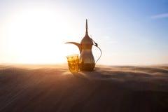 Arabic Coffee Pot. On desert dunes Royalty Free Stock Image