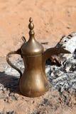 Arabic coffee pot at a fireplace Stock Photos