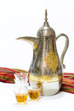 Arabic coffee pot and glasses. Arabic coffee from united arab emirates with glasses Royalty Free Stock Images