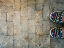 Arabic colored pattern shoes on wood texture pavements Royalty Free Stock Photo