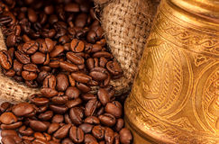 Arabic copper turks and  scattered coffee grains Stock Images