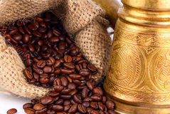 Arabic copper turks and  scattered coffee grains. Arabic old copper turks and  scattered coffee grains Stock Image