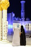Arabic couple at Sheikh Zayed Grand Mosque. ABU DHABI, UAE - OCTOBER 24, 2017: Arabic muslim couple at Sheikh Zayed Grand Mosque Royalty Free Stock Photos
