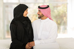 Arabic couple sitting bed Royalty Free Stock Photo