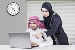 Arabic couple working together Royalty Free Stock Images