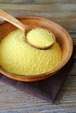 Arabic couscous in a clay bowl on boards. Food close up Stock Photos