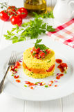 Arabic couscous with tomatoes and apricots Stock Photo